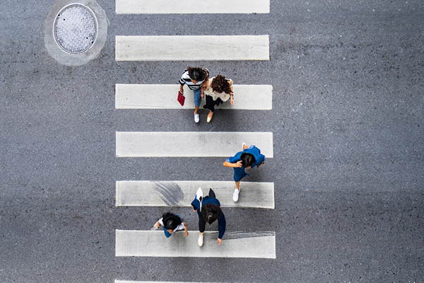People walking Overhead Crosswalk